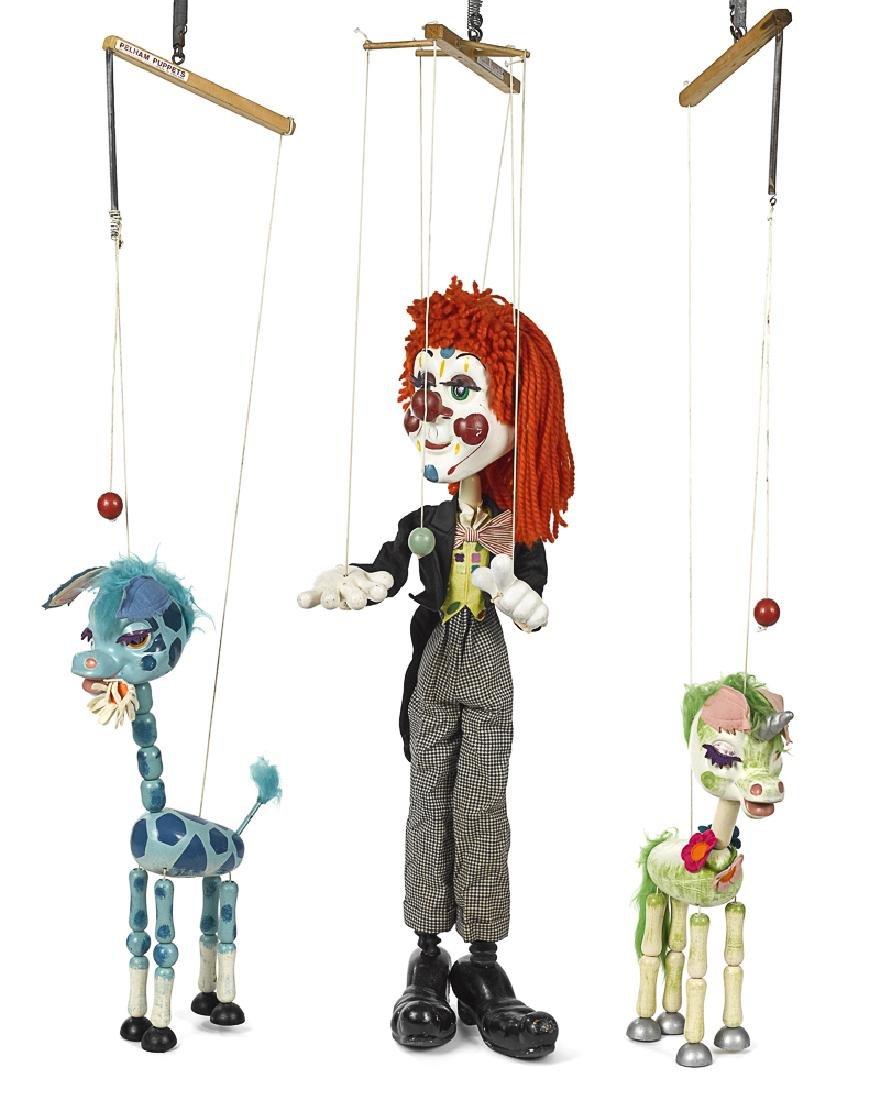 Three Pelham store display puppets