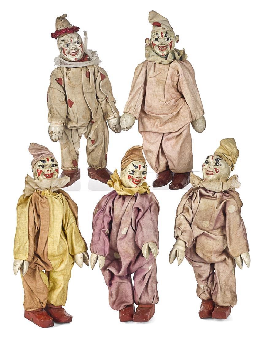 Five Schoenhut painted wood circus clowns
