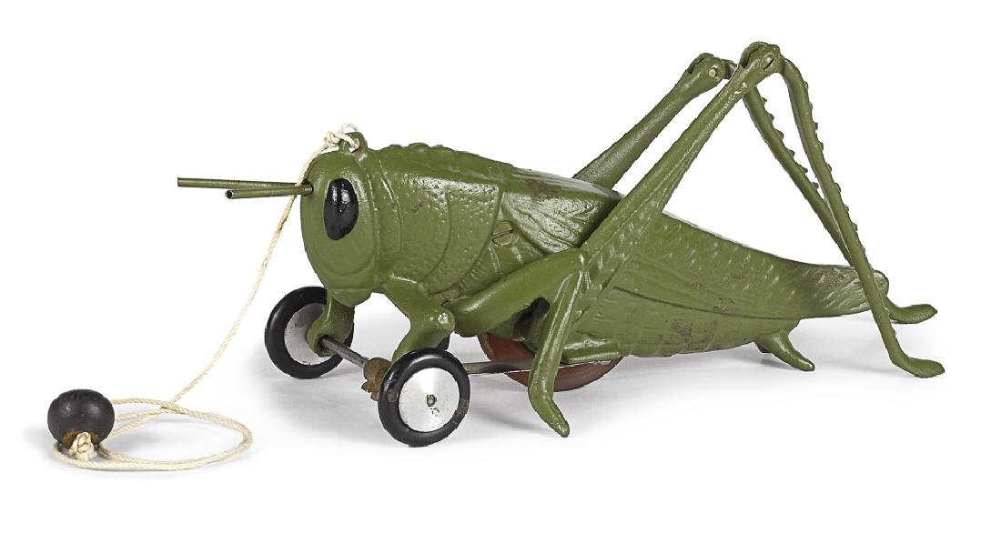 Reproduction Hubley grasshopper pull toy