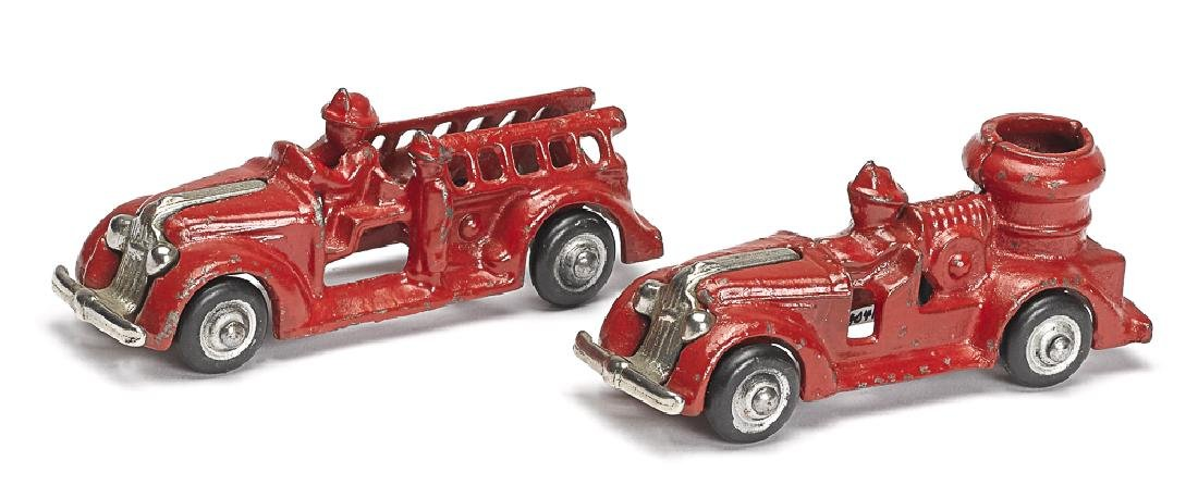 Two small Arcade cast iron fire trucks