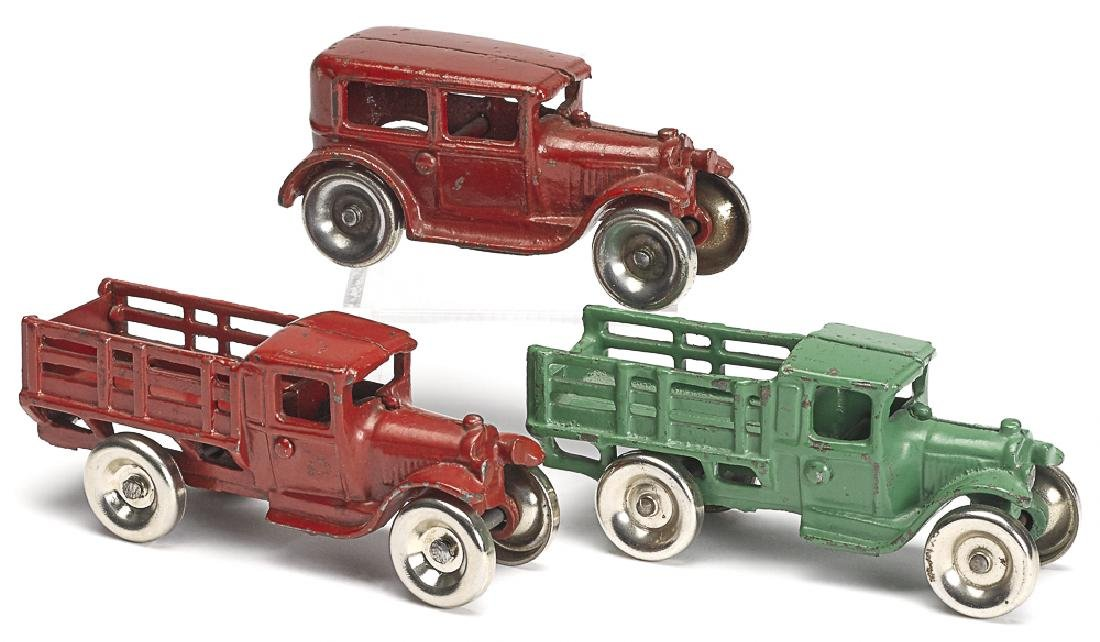 Three small Arcade cast iron vehicles
