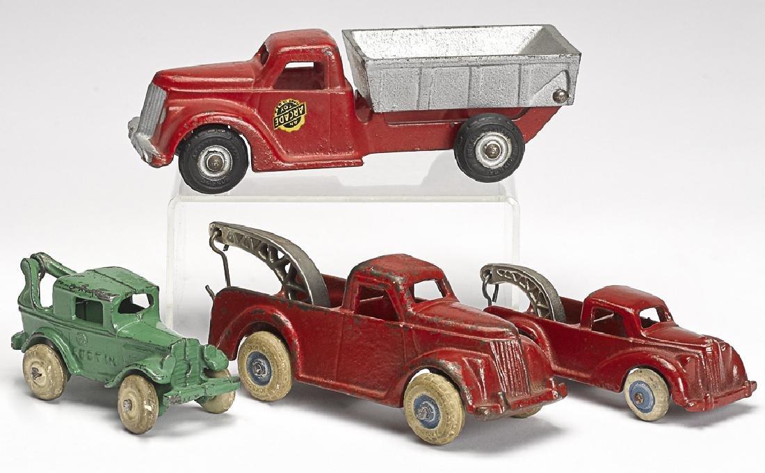 Four small Arcade cast iron vehicles