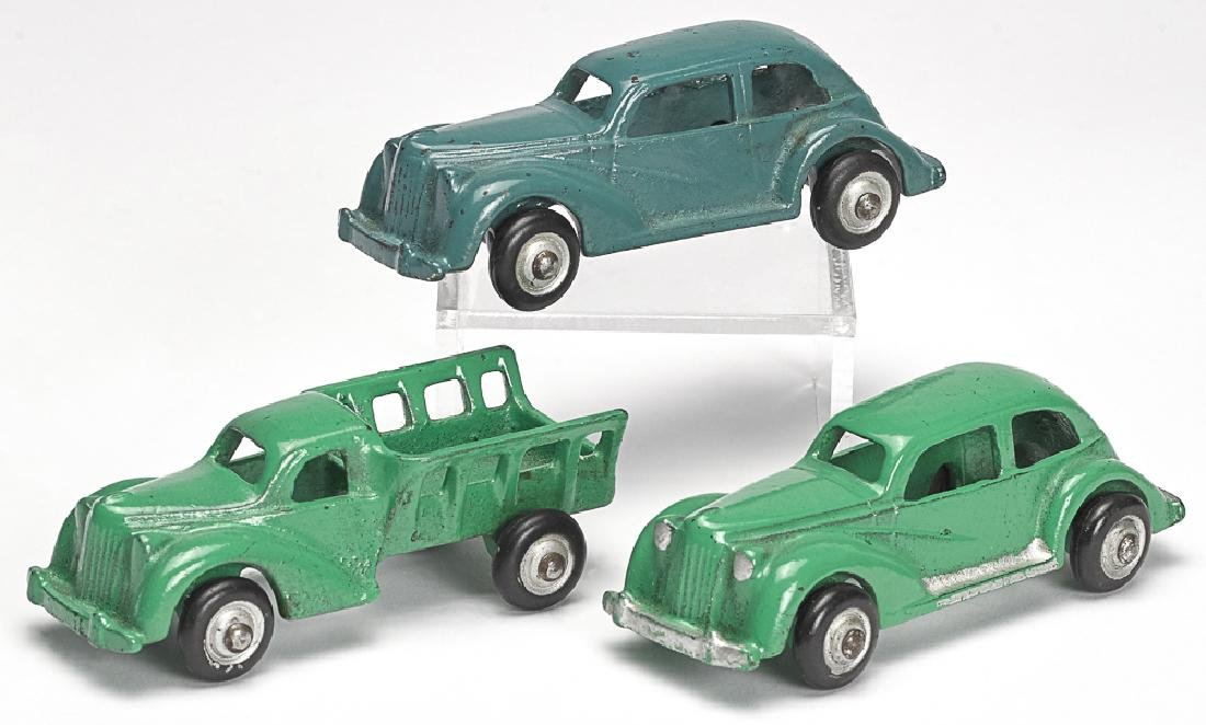 Three small Arcade cast iron cars