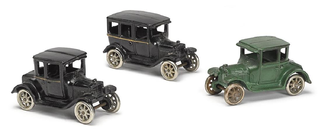 Three Arcade cast iron model T Ford cars