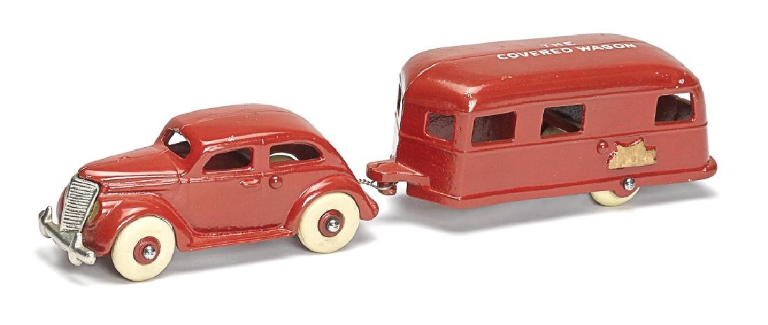 Reproduction of the Arcade cast sedan and trailer