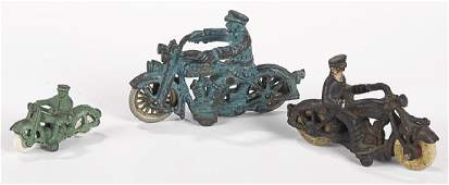 Three cast iron motorcycles