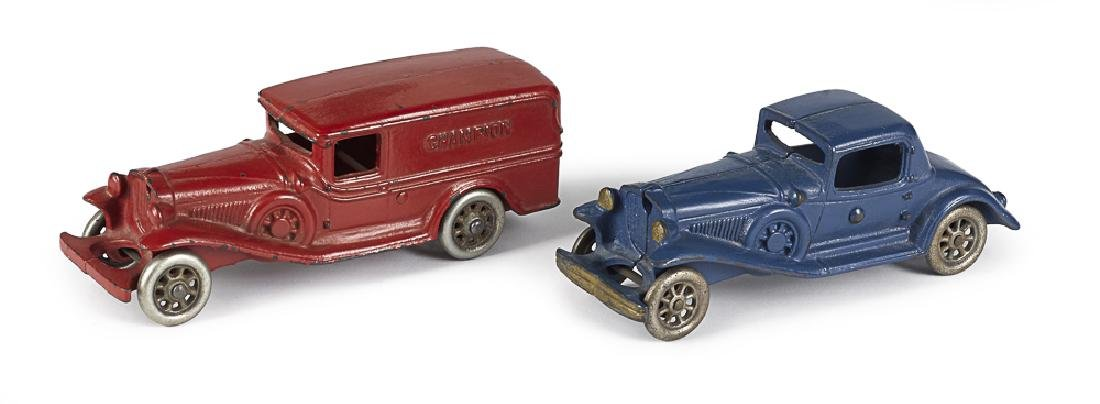 Two Champion cast iron vehicles