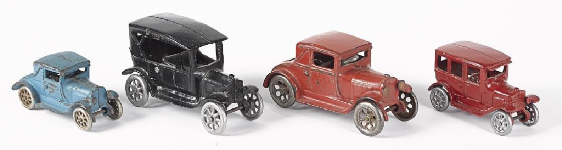 Four Arcade cast iron vehicles
