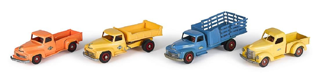 Four Product Miniatures International trucks