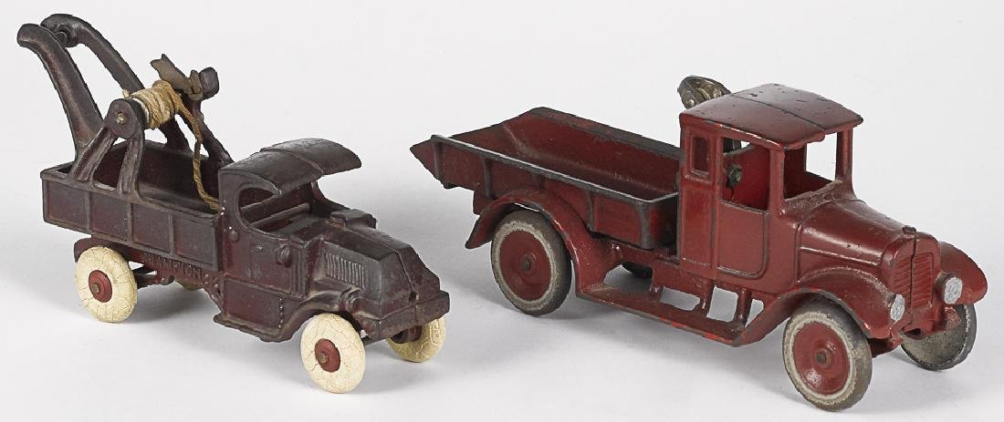 Two cast iron trucks