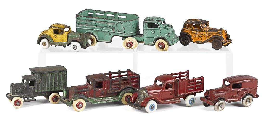Seven small cast iron vehicles