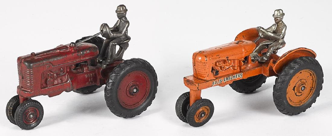 Two Arcade cast iron  tractors