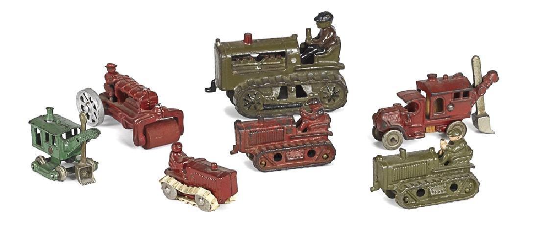 Three Hubley cast iron tractors