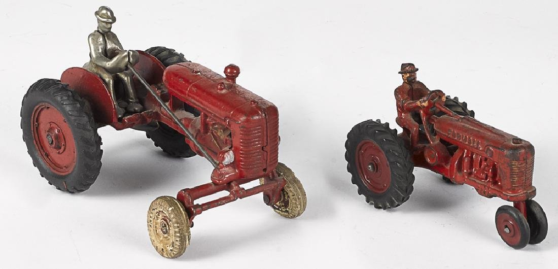 Two cast iron farm tractors