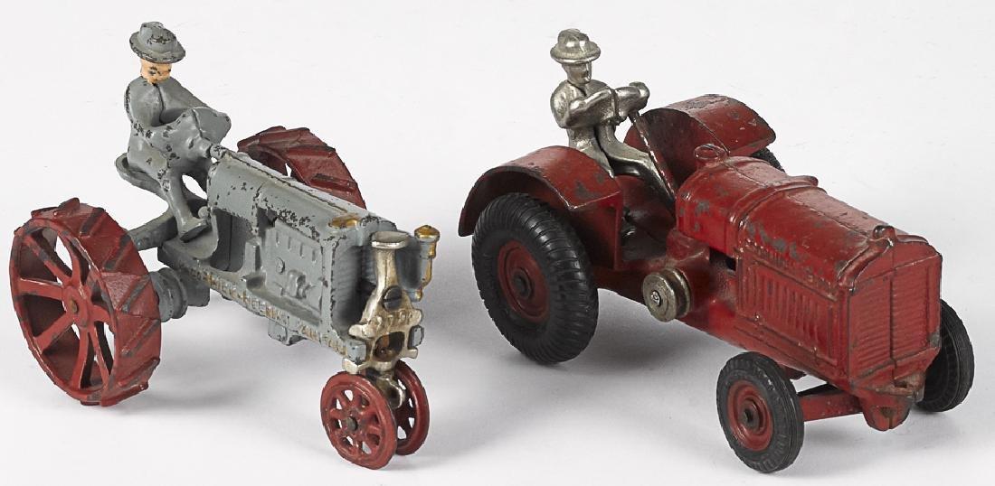 Two Arcade cast iron farm tractors