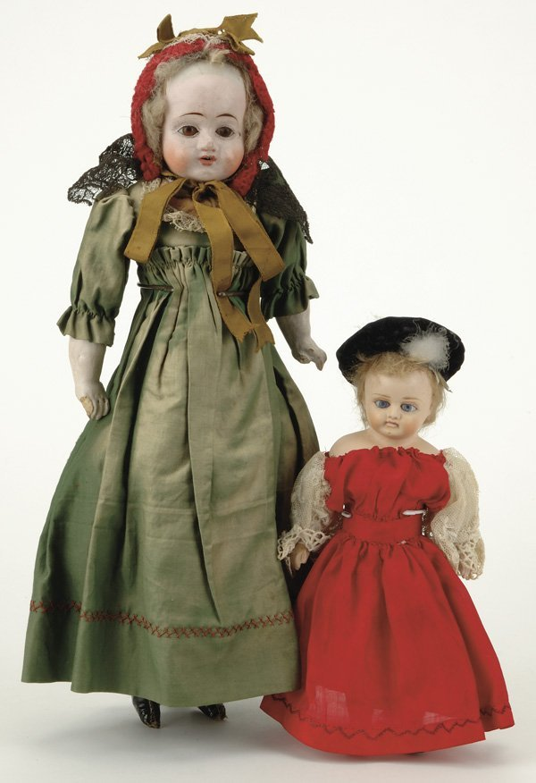 606: Lot: 2 German Papier Mache Children