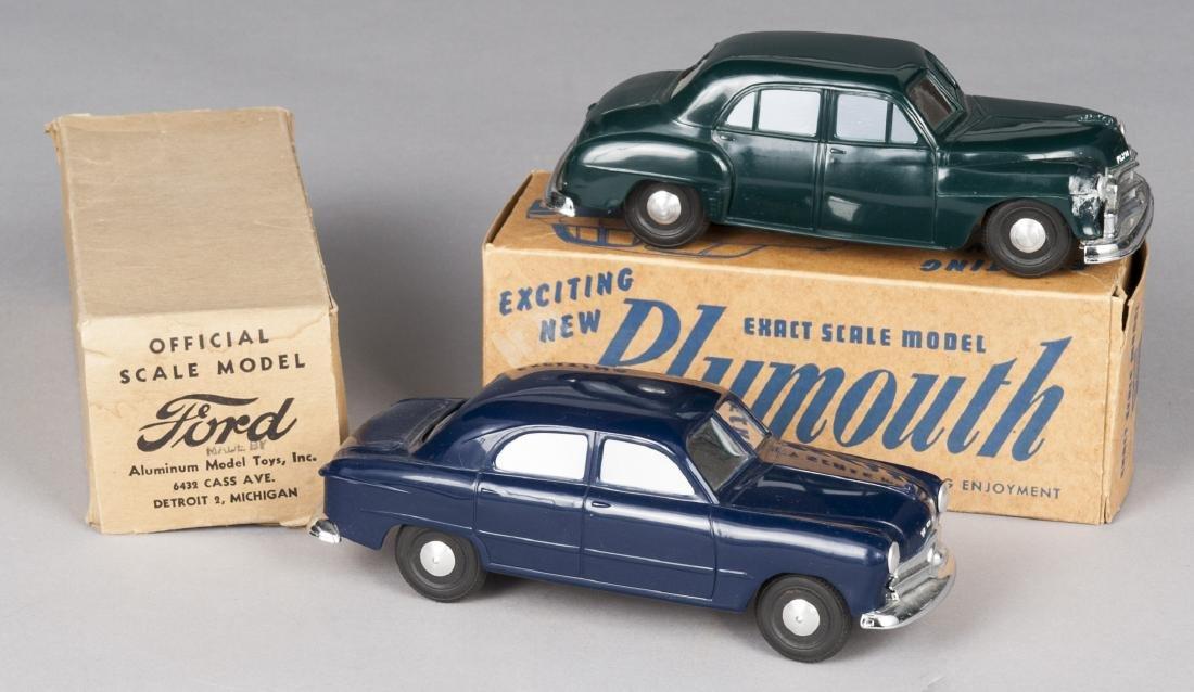 Two Aluminum Model Toys molded plastic windup car