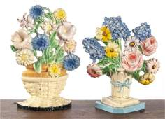 Two Hubley cast iron flower basket doorstops