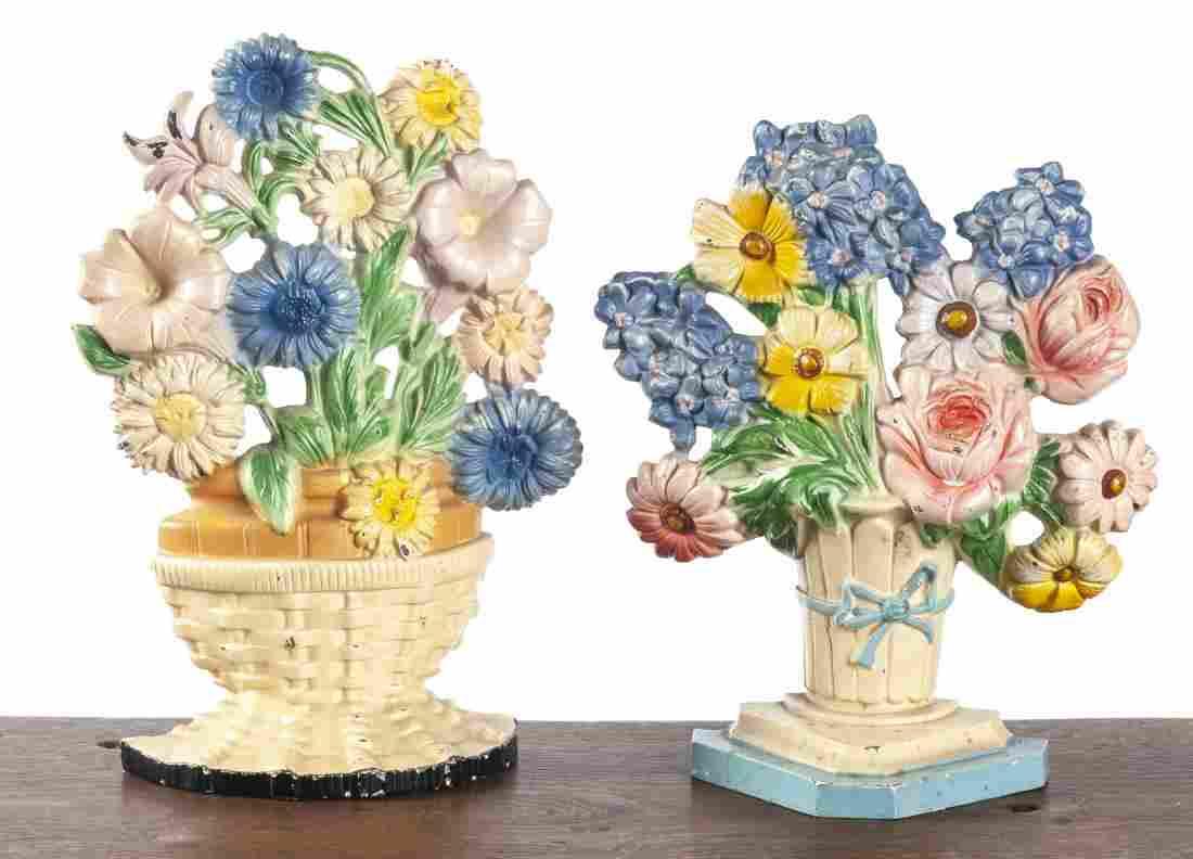 Two Hubley cast iron flower basket doorstops