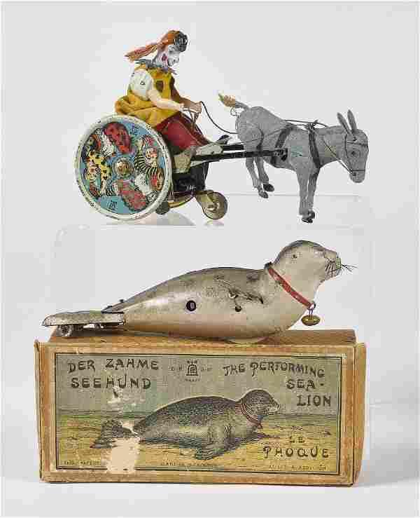 Two Lehmann wind-up tin toys