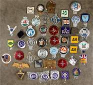 Large collection of car license badges