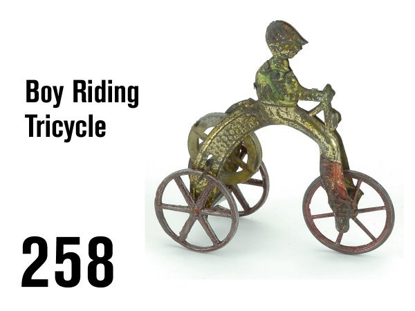 258: Boy Riding Tricycle