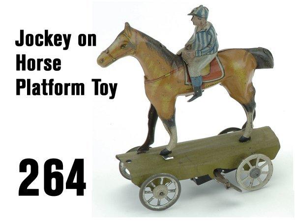 264: Jockey on Horse Platform Toy