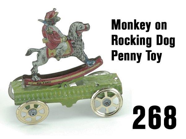 268: Monkey on Rocking Dog Penny Toy