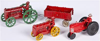 Three Arcade farm tractors with integral drivers