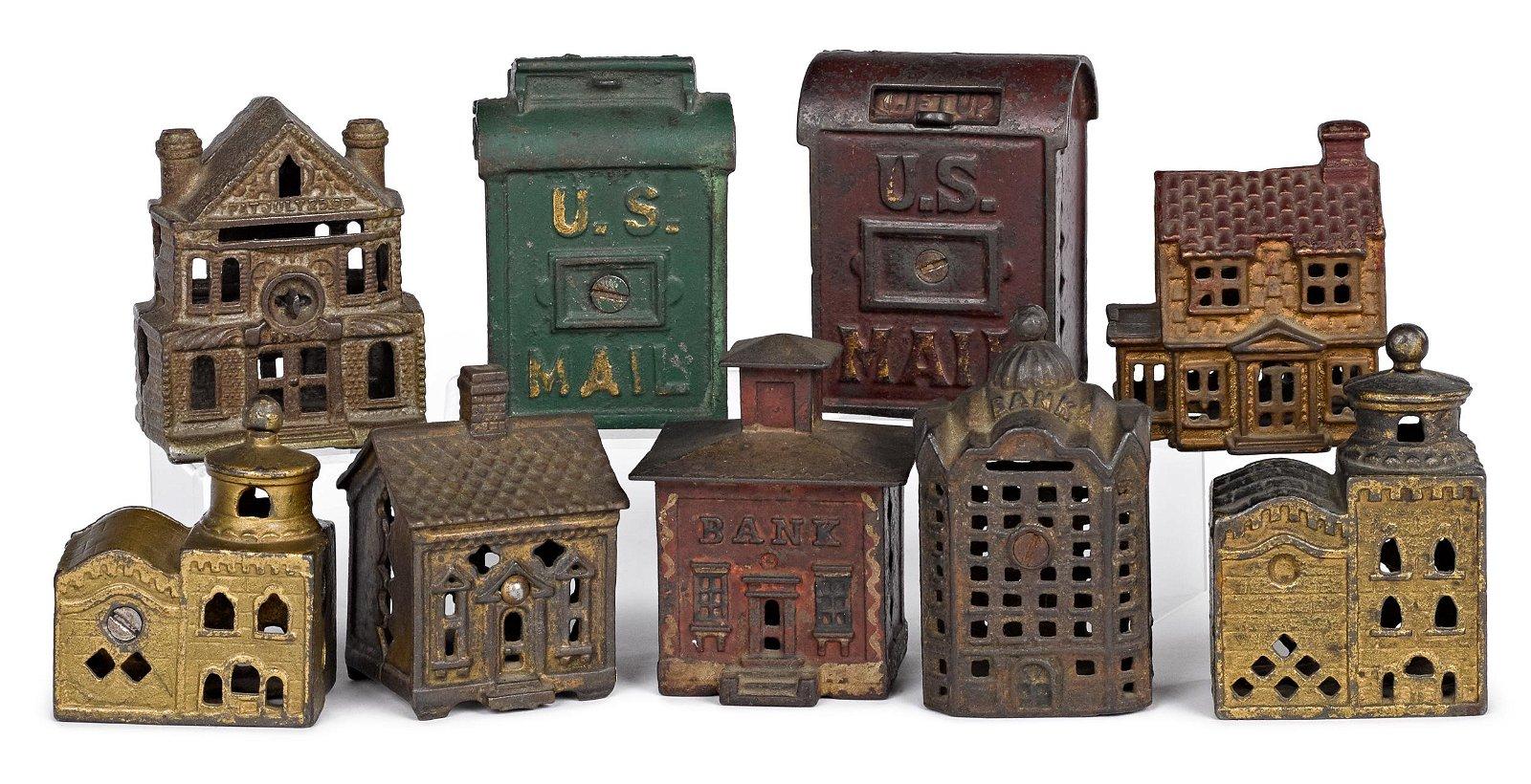 Nine cast iron still banks