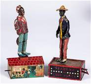 Two tin lithograph black Americana wind-up toys