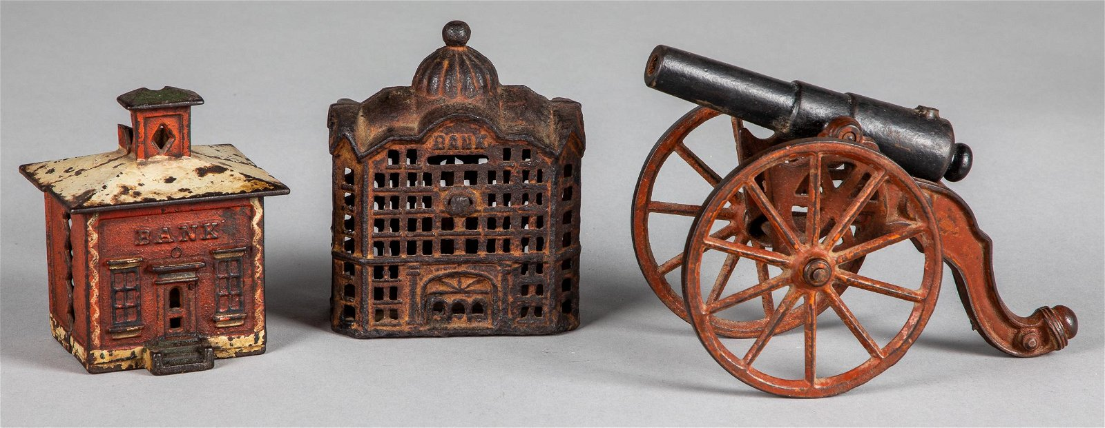 Three cast iron toys