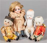 Four small bisque dolls, two all bisque
