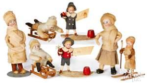Seven spun cotton bisque head Christmas ornaments