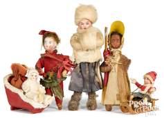 Four bisque head Christmas ornaments