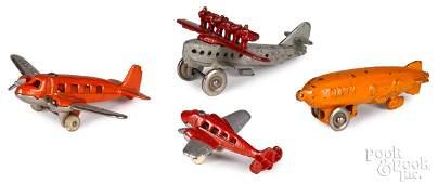 Three Hubley cast iron airplanes