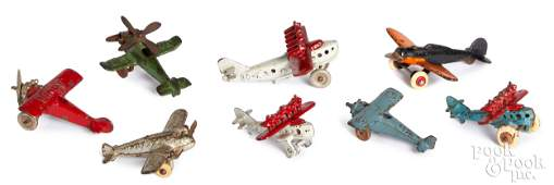 Eight Hubley cast iron airplanes