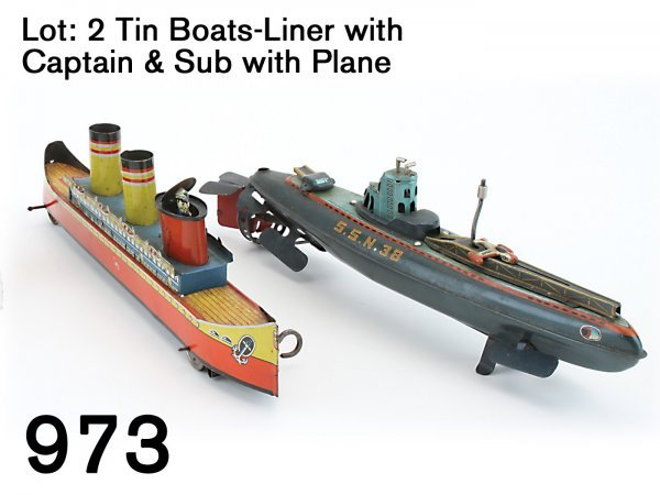 973: Lot: 2 Tin Boats - Liner with Captain & Sub with P