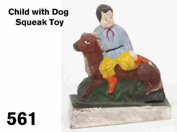 Child with Dog Squeak Toy