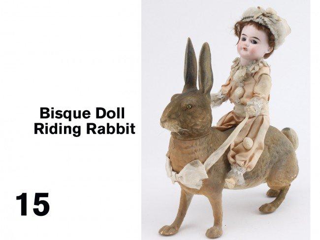 15: Bisque Doll Riding Rabbit