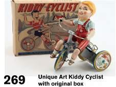 269: Unique Art Kiddy Cyclist with original box