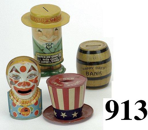 913: Lot: 4 Tin Still Banks
