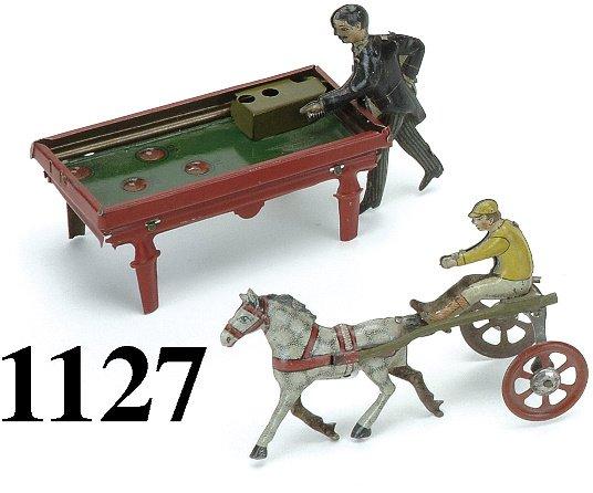 1127: Lot: 2 German Penny toys