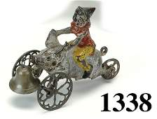 1338: Gong Bell Clown on Pig Bell Toy