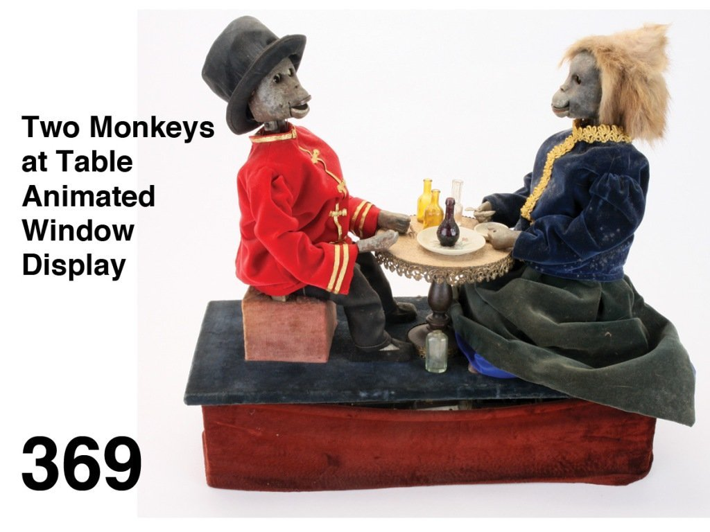 Two Monkeys at Table Animated Window Display