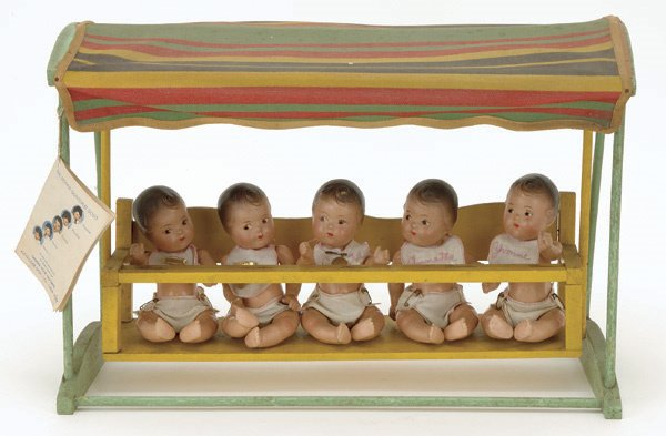 7: Dionne Quintuplets with Covered Swing