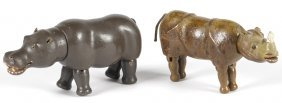 Two Schoenhut painted wood animals with glass e