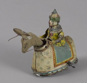 German hand painted clockwork clown riding a don