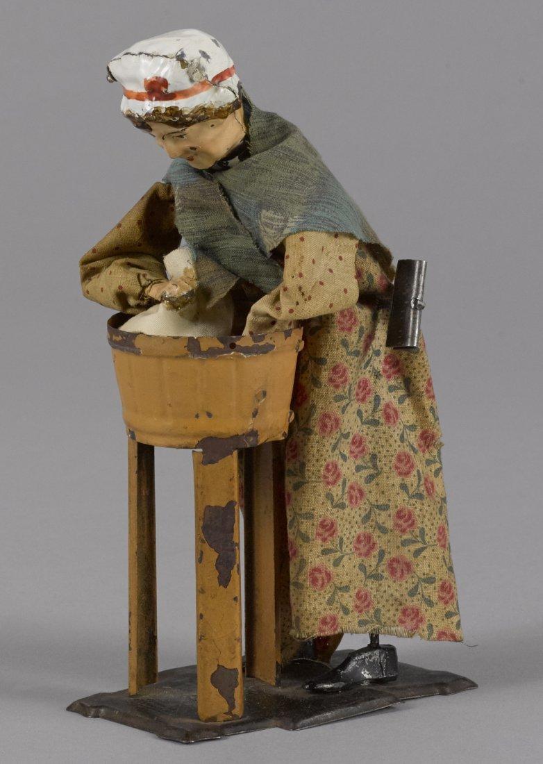 Ferdinand Martin hand painted tin clockwork woma