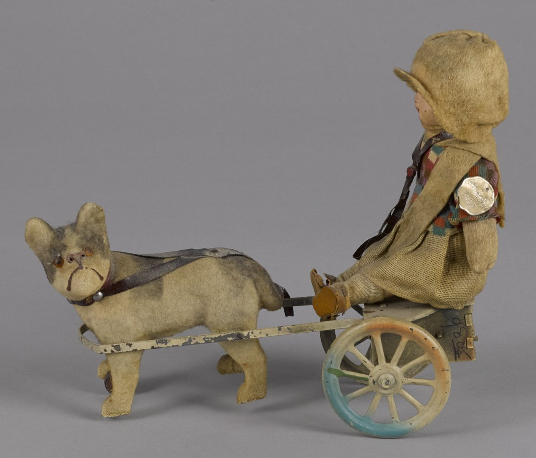 German painted tin and composition clockwork dog